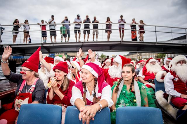 <p>People dressed as Santa Claus take part in the World Santa Claus Congress, an annual event held every summer in Copenhagen, Denmark, July 23, 2018. (Photo: Mads Claus Rasmussen/Ritzau Scanpix via Reuters) </p>