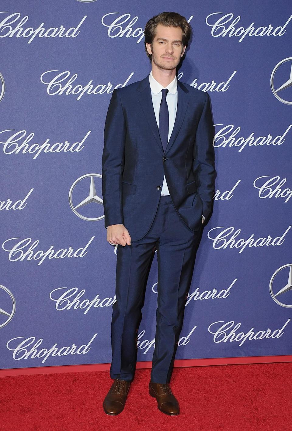 <p>Andrew, of 'Spiderman' fame, chose to rock a blue suit complete with skinny tie. [Photo: Getty] </p>