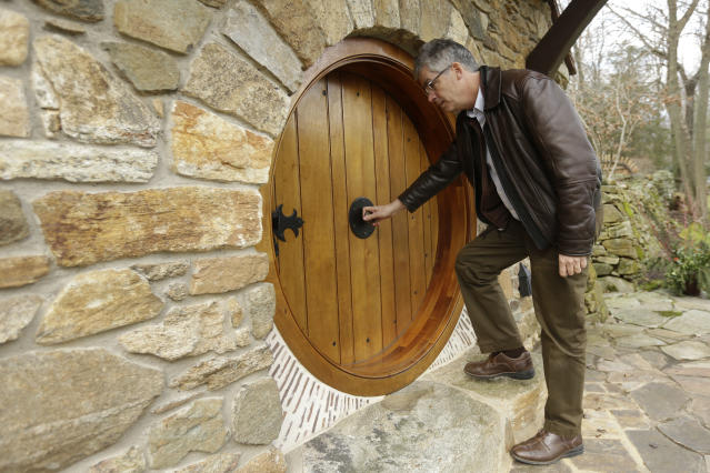 """Architect Peter Archer enters the """"Hobbit House"""" during and interview with the Associated Press Tuesday, Dec. 11, 2012, in Chester County, near Philadelphia. Archer has designed a """"Hobbit House"""" containing a world-class collection of J.R.R. Tolkien manuscripts and memorabilia. (AP Photo/Matt Rourke)"""
