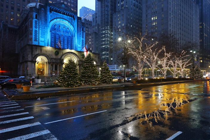 Christmas lights reflect off a rain-slicked Park Avenue outside St. Bartholomew's Church in midtown Manhattan. The church is a popular destination for visitors during the holiday season. (Photo: Gordon Donovan/Yahoo News)