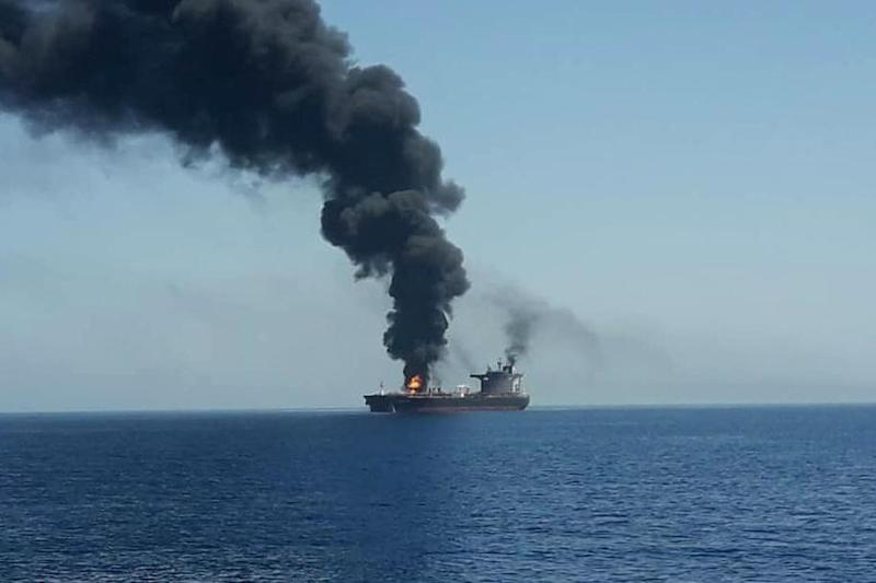 This picture shows one of the ships on fire during the suspected attack (AFP/Getty Images)