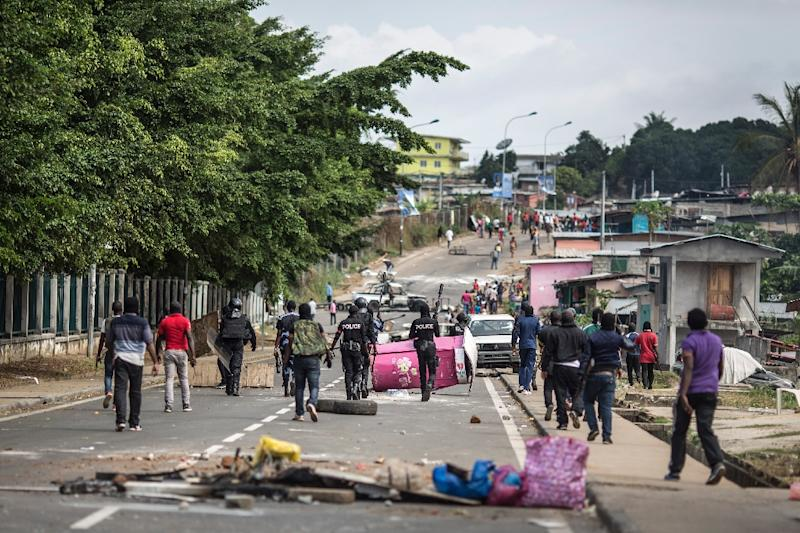 Police clear barricades in the streets adjacent to the National Assembly in Gabon's capital Libreville on September 1, 2016