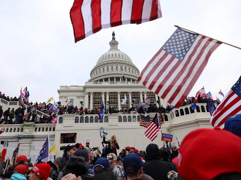 In this Wednesday 6 January 2021 file photo, supporters of Donald Trump gather outside the US Capitol in Washington, DC ((Associated Press))