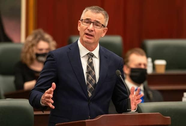 Alberta FInance Minister Travis Toews delivered figures Wednesday that show pandemic-related spending reached $5 billion last fiscal year. The money was spent on things such as hospitals, COVID-19 testing and vaccine distribution. (Jason Franson/The Canadian Press - image credit)