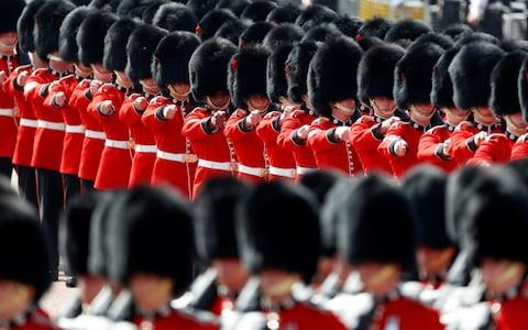 Coldstream Guards march down The Mall as part of Trooping the Colour in central London - Credit: Peter Nicholls/Reuters