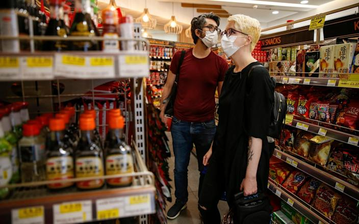 Customers wear face masks while shopping in Islington - Hollie Adams/Getty Images