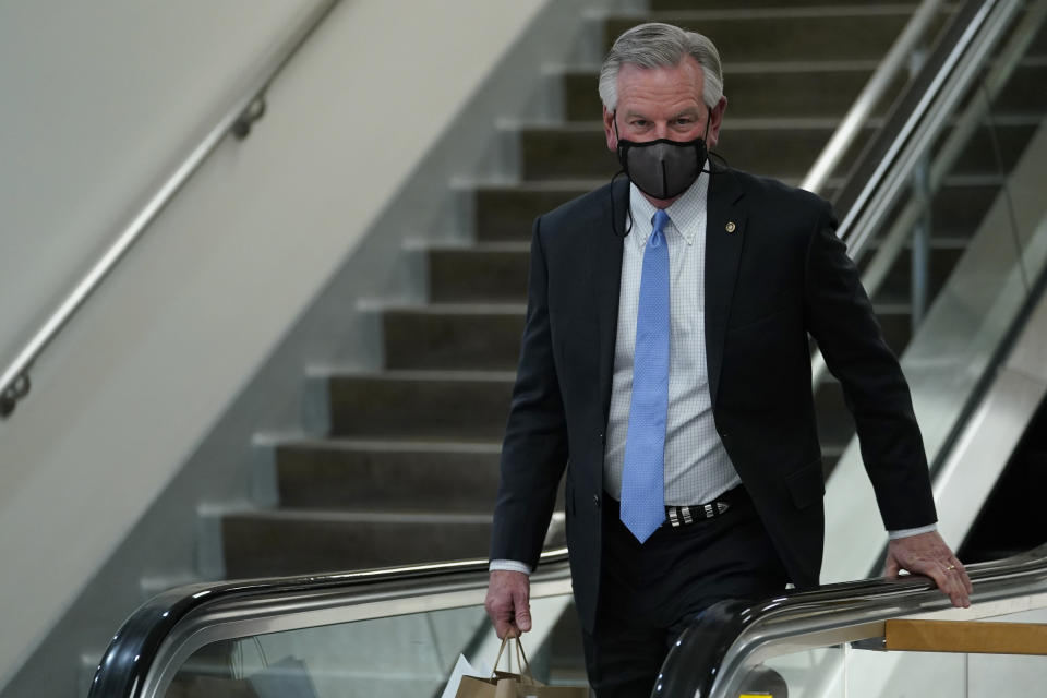 Sen. Tommy Tuberville, R-Ala., walks on Capitol Hill in Washington, Wednesday, Feb. 10, 2021, during a break on the second day of the second impeachment trial of former President Donald Trump. (AP Photo/Susan Walsh)