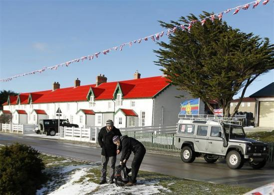 Tourists stand along Ross Road in Stanley, Falkland Islands June 11, 2012.