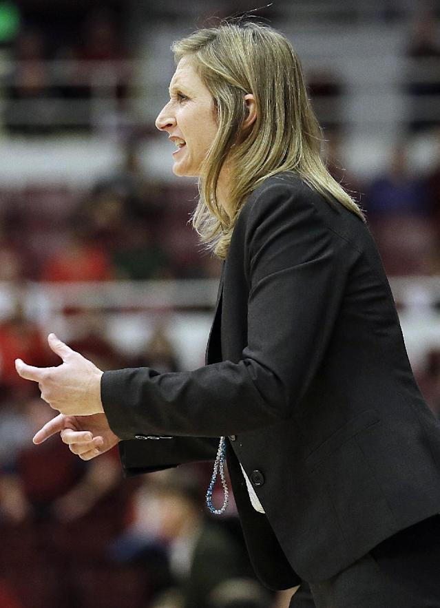 UC Davis head coach Jennifer Gross talks to her team from the sideline during the first half of an NCAA college basketball game against Stanford in Stanford, Calif., Sunday, Nov. 17, 2013. (AP Photo/Jeff Chiu)