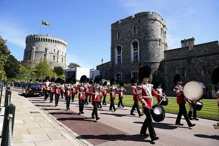 Members of the military march and play instruments outside Windsor Castle.