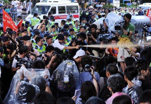 Police fire pepper spray at activists demanding China investigate Li Wangyang's death last month