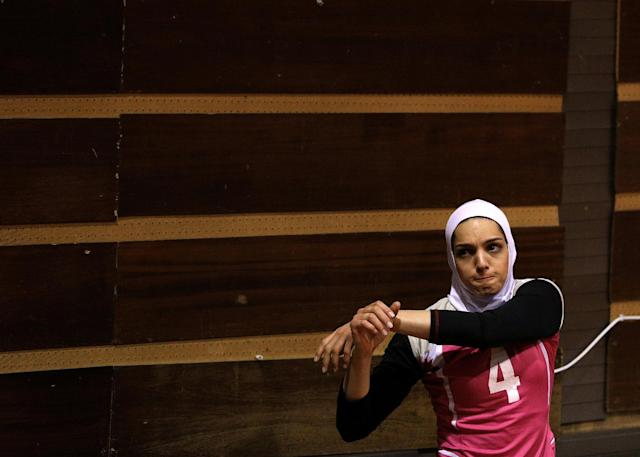 "Iranian volleyball player Maedeh Borhani warms up during a training session of ""Shumen"" volleyball club in Shumen, Bulgaria January 14, 2017. Picture taken on January 14, 2017. REUTERS/Stoyan Nenov"