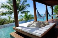"""<p>The day bed and hammocks really enhance the 'Gram' potential of this particular pool.</p><p>Book via: <a href=""""https://www.airbnb.co.uk/rooms/17975104?guests=3&adults=3&location=brazil&s=-xqAlzja"""" rel=""""nofollow noopener"""" target=""""_blank"""" data-ylk=""""slk:Airbnb"""" class=""""link rapid-noclick-resp"""">Airbnb</a></p>"""