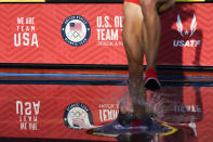 A runner enters the water in the first prelim of the women's 3000-meter steeplechase at the U.S. Olympic Track and Field Trials Sunday, June 20, 2021, in Eugene, Ore. (AP Photo/Ashley Landis)