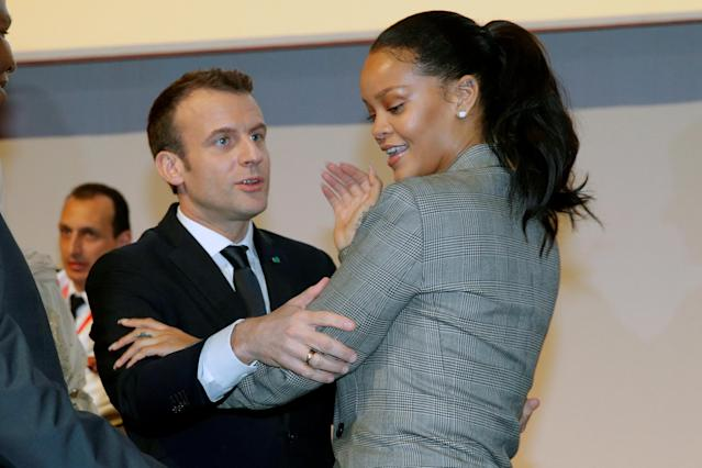 "French President Emmanuel Macron embraces singer Rihanna as they attend the ""GPE Financing Conference, an Investment in the Future"" organised by the Global Partnership for Education in Dakar, Senegal, February 2, 2018. REUTERS/Philippe Wojazer"