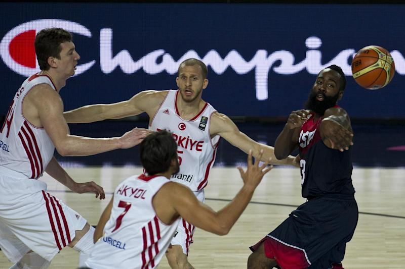 United States's James Harden, tries to controls the ball in front Turkey's Omer Asik, left, Cenk Akyol, and Sinan Guler, center back, during the Group C Basketball World Cup match, in Bilbao northern Spain, Sunday, Aug. 31, 2014. The 2014 Basketball World Cup competition take place in various cities in Spain from last Aug. 30 through to Sept. 14. (AP Photo/Alvaro Barrientos)