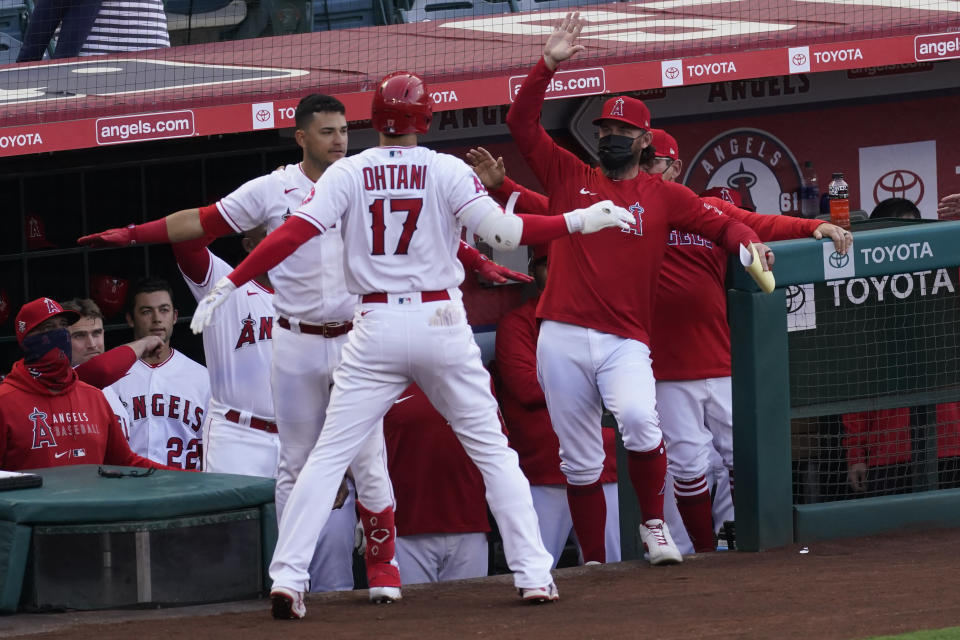 Los Angeles Angels' Shohei Ohtani (17) celebrates after hitting a home run during the first inning of a baseball game against the Chicago White Sox Sunday, April 4, 2021, in Anaheim, Calif. (AP Photo/Ashley Landis)