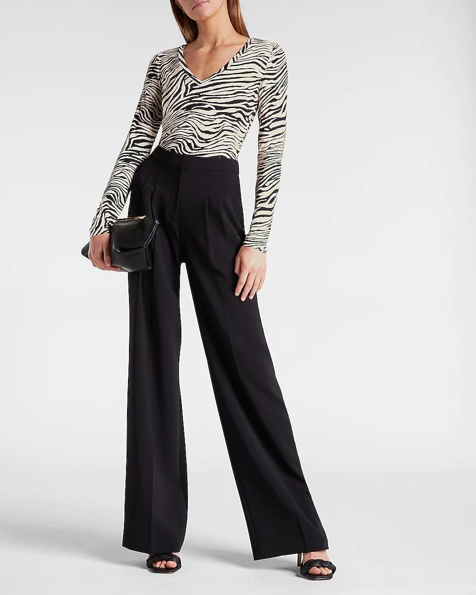 <p>A round neckline and striking pattern make this <span>Express Fitted Zebra Print V-neck Long Sleeve Tee</span> ($48) anything but boring. You'll love styling it with wide-leg trousers for an ensemble that exudes both confidence and elegance.</p>