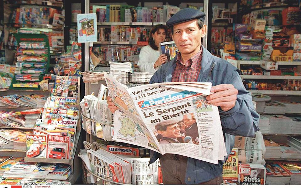 9 April 1997: Sobhraj enjoying reading about himself back in Paris after his release from jail in India - Shutterstock