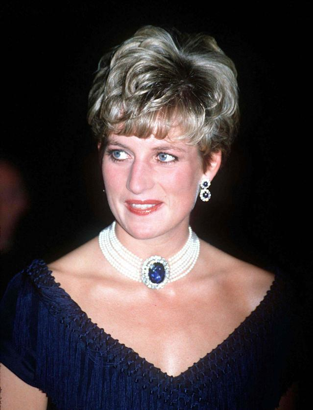 "<p>A sapphire brooch was given to the queen mother as a wedding gift, and Princess Diana was frequently photographed wearing it around her neck, held with a string of pearls. The Princess of Wales famously donned the necklace with the ""revenge dress"" she wore on the very evening it was revealed to the public that Prince Charles had been unfaithful. (Photo: PA) </p>"