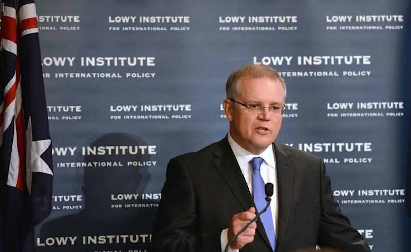 Australian Immigration Minister Scott Morrison speaks to the Lowy Institute for International Policy in Sydney on May 9, 2014 (AFP Photo/Peter Parks)
