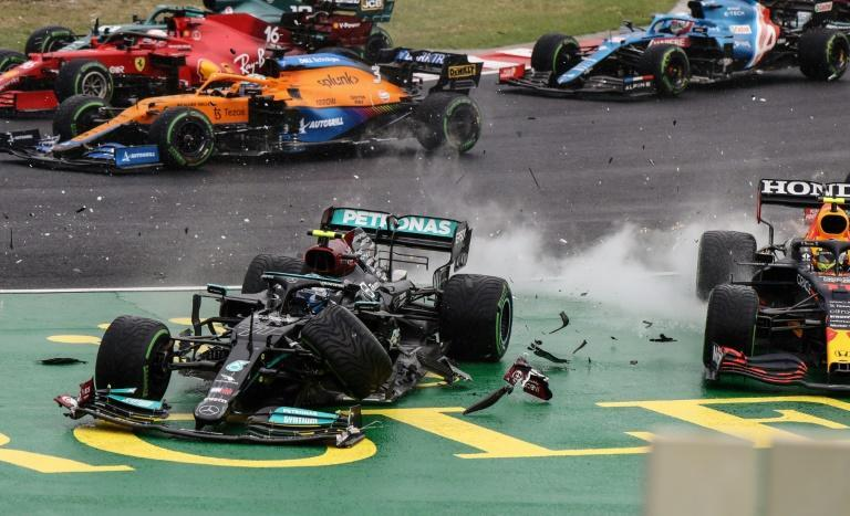 Mercedes' Valtteri Bottas collides with Red Bull's Sergio Perez on the opening lap of the Hungarian Grand Prix