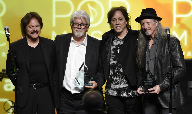 FILE - This April 29, 2015 file photo shows from left, Tom Johnston, Michael McDonald, John McFee and Pat Simmons of the Doobie Brothers after receiving the ASCAP Voice of Music Award at the 32nd Annual ASCAP Pop Music Awards in Los Angeles. The band will be inducted into the Rock and Roll Hall of Fame, joined by Depeche Mode, Nine Inch Nails and T-Rex. (Photo by Chris Pizzello/Invision/AP, File)