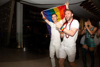 Olympic medalist and Pride Party at Sea Grand Marshal Adam Rippon celebrating Pride Month with Celebrity Cruises alongside both guests and crew on board the brand's newest ship, Celebrity Edge.