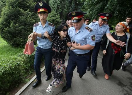 FILE PHOTO: Police officers detain an opposition supporter during a protest against presidential election results, in Almaty