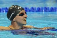 Katie Ledecky reacts after winning the Women's 400 Freestyle during wave 2 of the U.S. Olympic Swim Trials on Monday, June 14, 2021, in Omaha, Neb. (AP Photo/Charlie Neibergall)