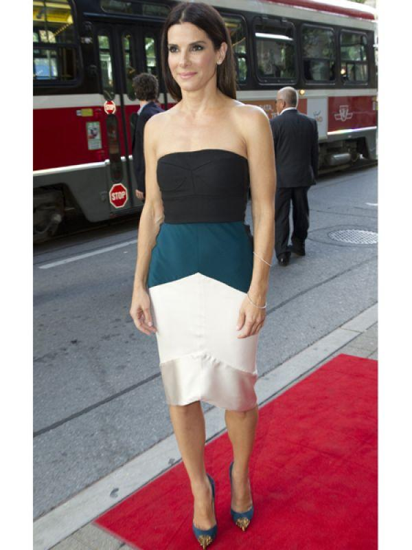 <p><strong>Sandra Bullock</strong>: The pretty actress appeared in a strapless colour block outfit by Narciso Rodriguez for the premiere of her new film <em>Gravity</em>.</p>