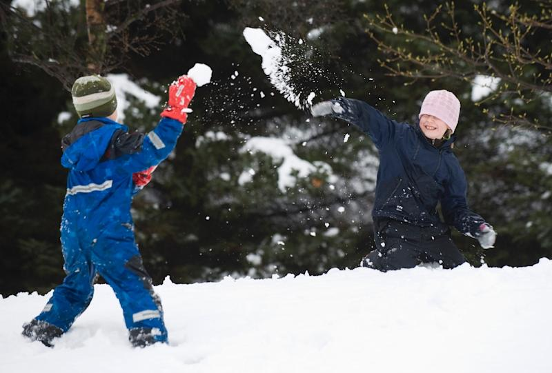 Children play in the snow in a park in Reykjavik on May 1, 2011 (AFP Photo/Jonathan Nackstrand)