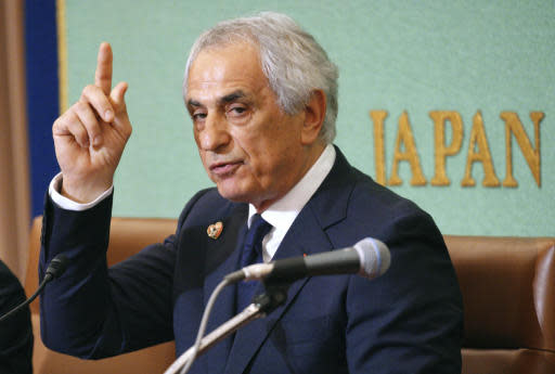 FILE - In this April 27, 2018, file photo, former Japanese national soccer coach Vahid Halilhodzic speaks during his press conference in Tokyo. Fired Japan national team football coach Halilhodzic is suing the Japanese federation and president Kozo Tashima for his dismissal last month - just two months before the opening of the World Cup. Lionel Vincent, the lawyer representing Halilhodzic, told the Associated Press on Monday, May 21, 2018, that the suit asks for an apology from Tashima and indemnification of 1 Japanese yen - less than 1 US cent.(AP Photo/Eugene Hoshiko, File)