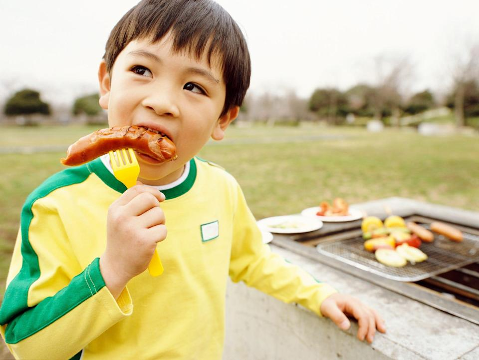 Usually around age 4, children are at less risk to choke while eating a hot dog that is not cut up.