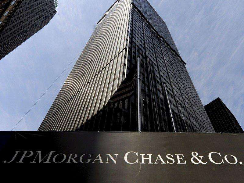 JPMorgan revises profit amid trading probe