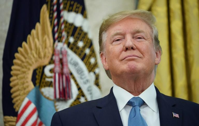 """""""We don't need China and, frankly, would be far... better off without them,"""" US President Donald Trump tweeted (AFP Photo/MANDEL NGAN)"""