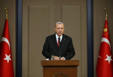 FILE PHOTO: Turkish President Erdogan speaks at Esenboga Airport in Ankara