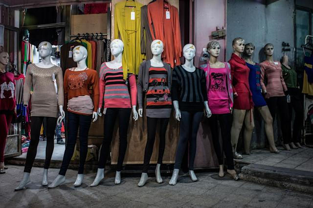 <p>Manequins show off available clothing in a shop near the main street of Gaza. (Photograph by Monique Jaques) </p>