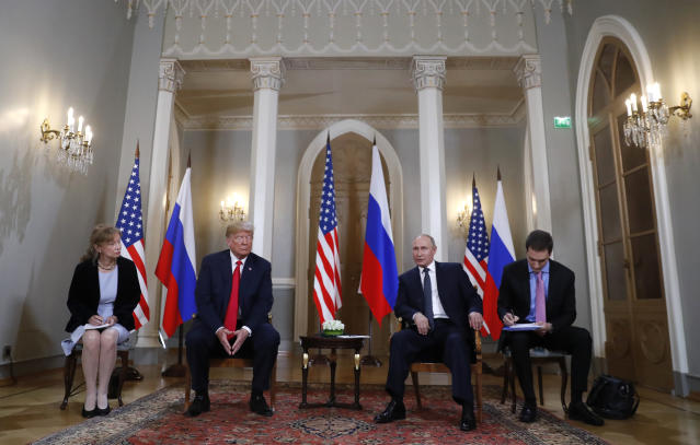 <p>U.S. President Donald Trump, second from left, listens to a statement of Russian President Vladimir Putin, second from right, at the beginning of a meeting at the Presidential Palace in Helsinki, Finland, July 16, 2018. (Photo: Pablo Martinez Monsivais/AP) </p>