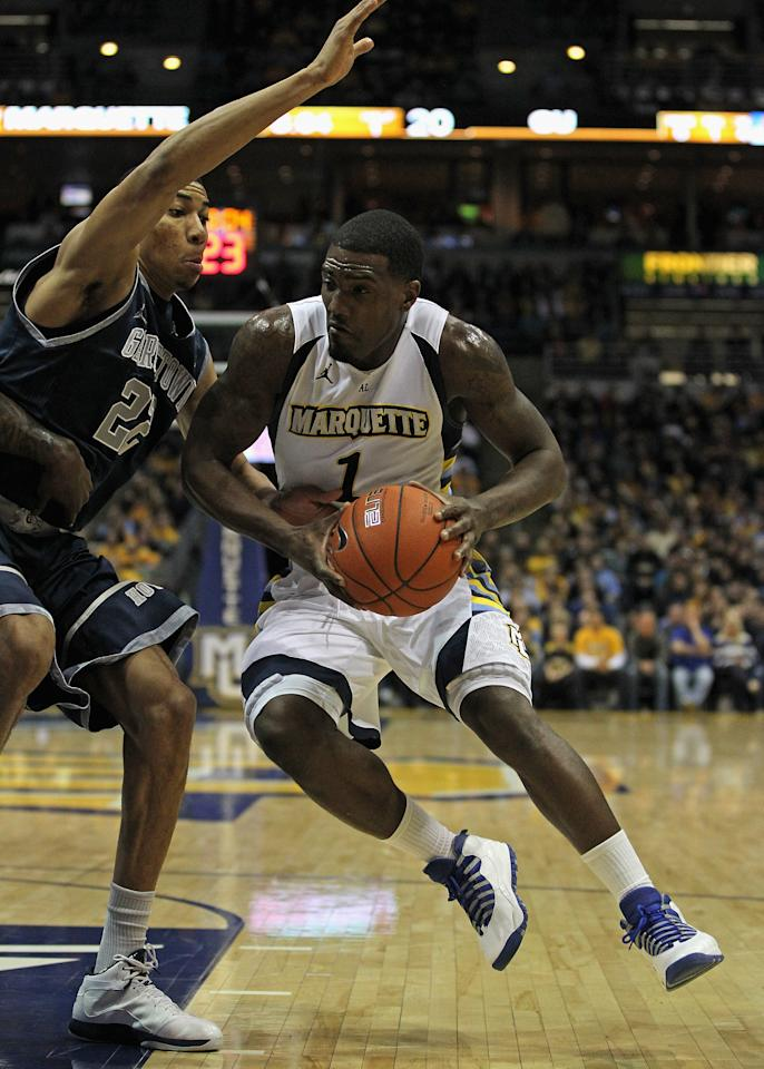 MILWAUKEE, WI - MARCH 03: Darius Johnson-Odom #1 of the Marquette Golden Eagles drives against Otto Porter #22 of the Georgetown Hoyas at the Bradley Center on March 3, 2012 in Milwaukee, Wisconsin. Marquette defeated Georgetown 83-69. (Photo by Jonathan Daniel/Getty Images)