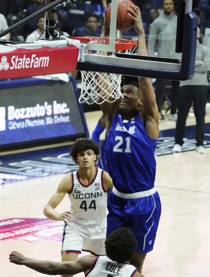 Seton Hall center Ike Obiagu (21) makes a basket against Connecticut guard R.J. Cole (1) during the second half of an NCAA college basketball game, Saturday, Feb. 6, 2021, at Harry A. Gampel Pavilion in Storrs, Conn. (David Butler II/Pool Photo via AP)