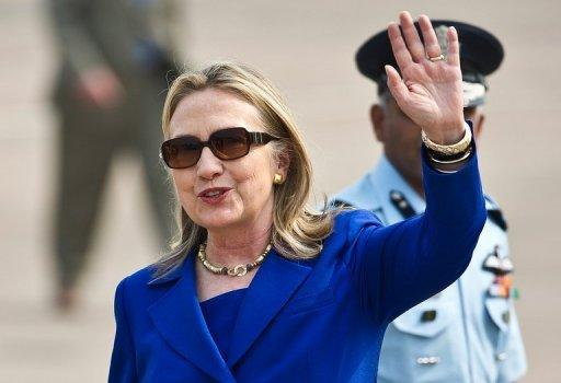 US Secretary of State Hillary Clinton waves on her arrival at Palam Air Force Station in New Delhi. Clinton has urged India to further cut its imports of Iranian oil, saying that the Islamic republic posed a major threat if it developed nuclear weapons