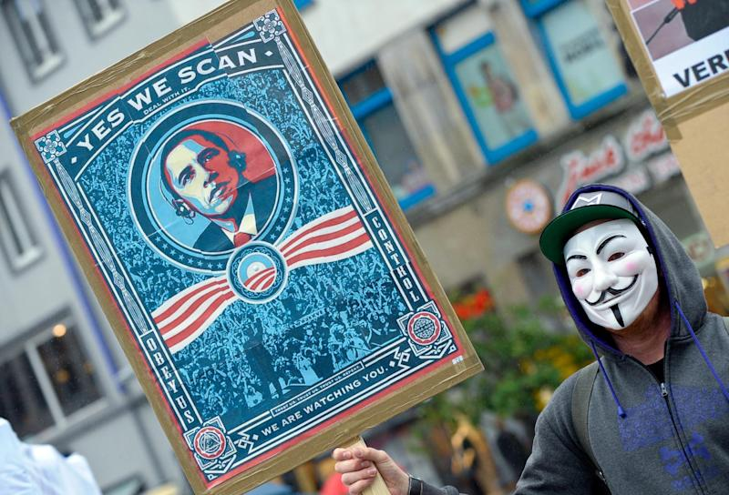 "In this picture, taken Saturday June 29, 2013, a demonstrator protests with a poster against NSA in Hanover, Germany. Germany's top justice official says reports that U.S. intelligence bugged European Union offices remind her of ""the methods used by enemies during the Cold War."" Justice Minister Sabine Leutheusser-Schnarrenberger was responding to a report by German news weekly Der Spiegel on Sunday June 30, 2013, that claimed the National Security Agency has eavesdropped on EU offices in Washington, New York and Brussels. The magazine cited classified U.S. documents taken by NSA leaker Edward Snowden that it said it had partly seen. The documents reportedly describe the European Union as a ""target"" for surveillance. (AP Photo/dpa, Peter Steffen)"