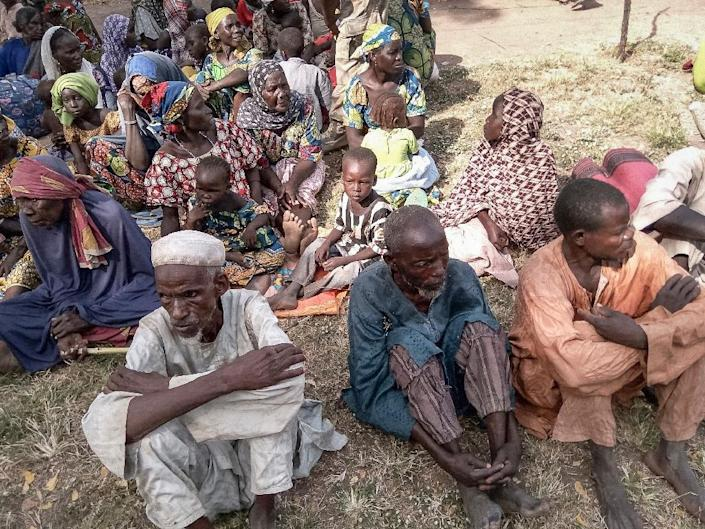 A picture released on October 28, 2015 of some of 338 people rescued by the Nigerian Army after being held by Boko Haram, seen in Muci (AFP Photo/)