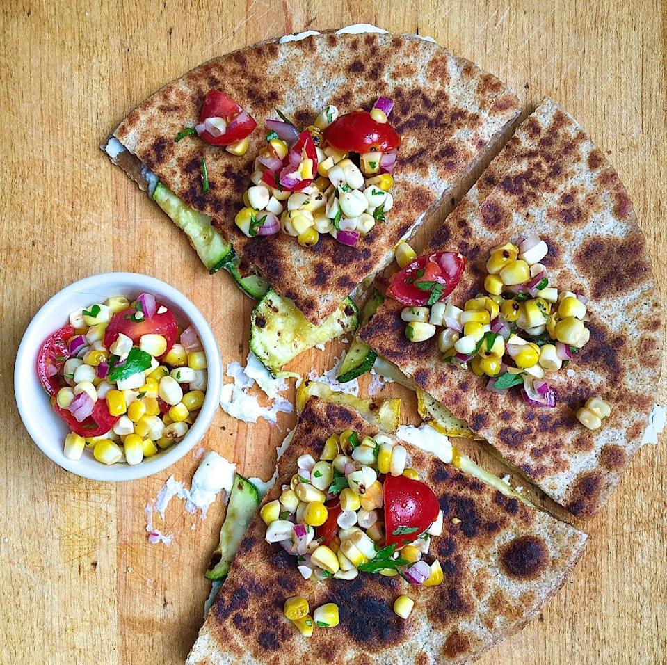 """<p>You can do better than a plain cheese quesadilla.</p><p>Get the recipe from <a href=""""https://www.delish.com/cooking/recipe-ideas/recipes/a42994/goat-cheese-zucchini-quesadillas-grilled-corn-pico-de-gallo/"""" rel=""""nofollow noopener"""" target=""""_blank"""" data-ylk=""""slk:Delish"""" class=""""link rapid-noclick-resp"""">Delish</a>.</p>"""