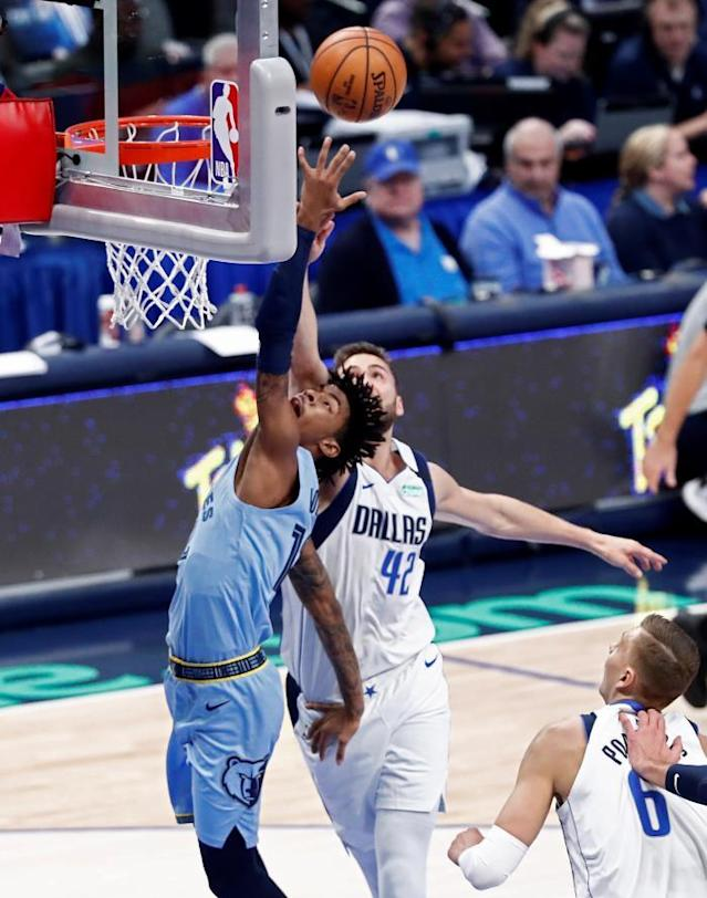 Memphis Grizzlies guard Ja Morant (L) goes to the basket against Dallas Mavericks forward Maxi Kleber (R) of Germany in the first half of the NBA basketball game between the Memphis Grizzlies and the Dallas Mavericks at the American Airlines Center in Dallas, Texas, USAEFE/LARRY W. SMITH