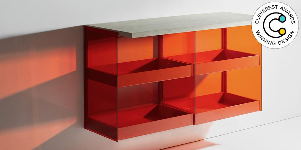 RGB Wall-Mounted Furniture System by Diez Office for Burgbad Most wall-mounted storage is of the very basic or very industrial variety. Not the RBG system. Made from extruded aluminum profiles, tinted-glass sidewalls, and attachable shelves and drawers, its hangable pieces will make your knickknacks look like they're floating in a sea of color. The modular system allows for layering, too, so you can create all sorts of color palettes. Oh, and the whole thing is expandable, simple to transport, and easy to assemble. diezoffice.com
