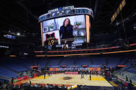 Vice President Kamala Harris is shown with a framed Golden State Warriors jersey on the video screen at Chase Center during the first half of an NBA basketball game between the Warriors and the San Antonio Spurs in San Francisco, Wednesday, Jan. 20, 2021. (AP Photo/Jeff Chiu)