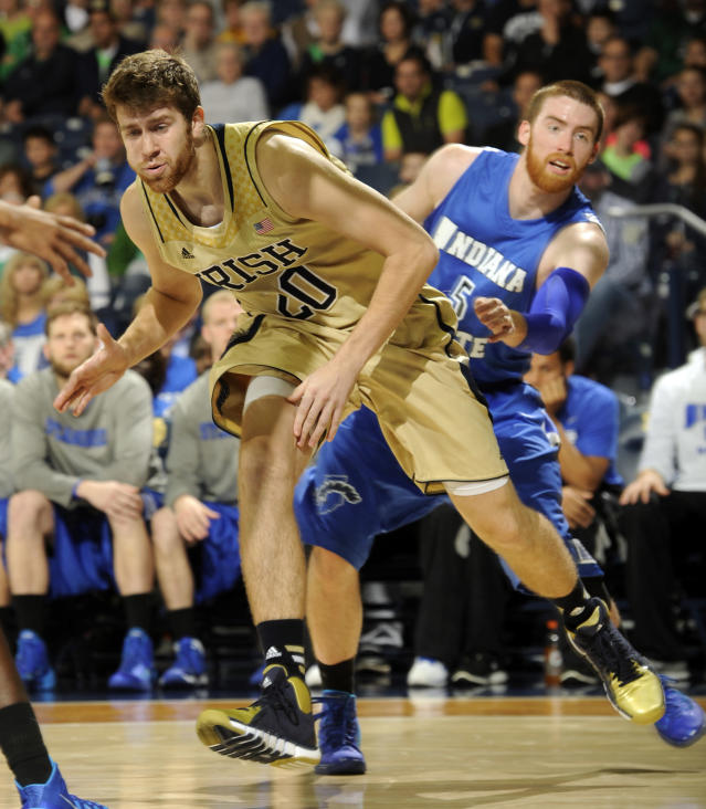 Notre Dame forward Austin Burgett, left, has the ball slapped away by Indiana State forward Justin Gant during the first half of an NCAA college basketball game Sunday, Nov. 17, 2013, in South Bend, Ind. (AP Photo/Joe Raymond)