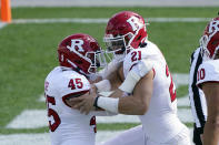 Rutgers quarterback Johnny Langan (21) is congratulated by tight end Brandon Myers (45) after his 1-yard touchdown during the first half of an NCAA college football game against Michigan State, Saturday, Oct. 24, 2020, in East Lansing, Mich. (AP Photo/Carlos Osorio)